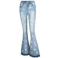 Женщины Blue Jean высокая талия джинсы клеш Daisy Цветочный Печатный Flare джинсы 2020 Streetwear Vintage Омывается Denim Jean Брюки