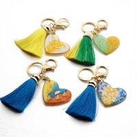 Nouvelle marque Porte-clés Porte-clés Charms forme de coeur Tassel Pendentif Sac Accessoires Mode fleur papillon voiture Porte-clés Porte-anneau pour les femmes