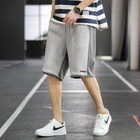 Para hombre Pantalones cortos de verano Nueva flojos rectos ocasionales de cinco puntos pantalones elásticos jóvenes color sólido pantalones deportivos japoneses
