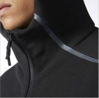 Tracksuit Hommes Vêtements de printemps Nouveaux Costumes Sports pour hommes Black White Tracksuits Jacket à capuche Hommes / Femmes Windbreaker Zipper