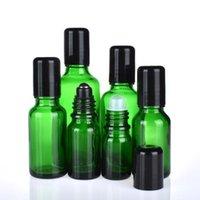 زجاجات التخزين الجرار 12 قطعة / الوحدة الأخضر الزجاج لفة على زجاجة فارغة الضروري النفط مع أسود معدني Rollon 5ML 10ML 15ML 20ML 50ML 50ML 50ML 100ML