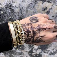 Herren-Armband 4pcs / set Krone Charme Schmuck Makramee Perlen Armbänder flechten Mann Luxuxschmucksachen für Frauen Armband Geschenk CX200724