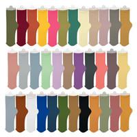 نساء الجوارب متعددة الألوان الصيف رقيقة جوارب المخملية كومة من الجوارب الصلبة اللون العقص الجليد سوك جوارب