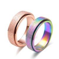Großhandel Rose Gold Titan Stahl Frosted Drehen Ringe Bunte Perlen Sand Ring Schmuck Hersteller-direktes freies Verschiffen