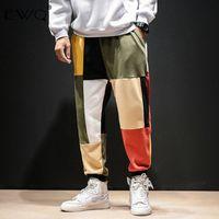 EWQ / remiendo del color Harem Hombres 2020 Hombres Streetwear Joggers casuales pantalones masculinos resorte de la vendimia de algodón pantalón Tide 9A379