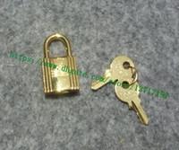 Accesorios de la bolsa de grado de alto grado Un set 1 BLOQUEO 2 Tecla pulida tono de oro brillo para Berkin Keally Collar Charm Alloy de metal de acero inoxidable 0056 079 grabado