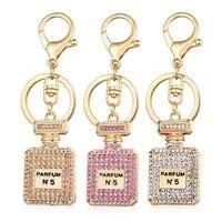 Moda Perfume Garrafa Encantos Acessórios Chave Ring 3 Cores Rhinestone Cristal Perfume Garrafa Keychain Chaveiro Presente Ornamentos
