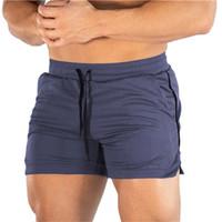 Mens Shorts Nuoto Jogging Correre Palestra Sport Fitness Exercise Workout traspirante estate pantaloni della tuta di addestramento Surf consiglio Shorts