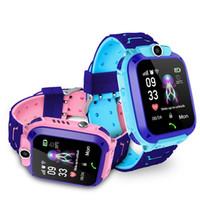 Q12 Windours Smart Watch SOS Teléfono SmartWatchs con tarjeta SIM Photo Impermeable IP67 Niños Regalo para iOS Android