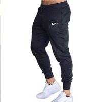 Corredores sweatpants homens calças casuais skinny esporte calças macho ginásio exercício de fitness treinamento de algodão trackpants executando sportswear