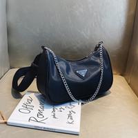 Francés no convencionales de las axilas bolso femenino 2020 del resorte del modelo nuevo Todo-fósforo de la cadena del hombro Bolso de nylon / bolso de mano del bolso al por mayor Baguette