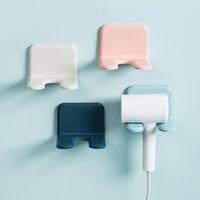 Bagno di stoccaggio Organizzazione Bracket senza foro Asciugacapelli Asciugacapelli WC a parete Appeso Rack Candy Color Shelf