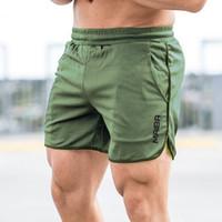 Новые дизайнерские мужчины Спортивные пляжные брюки Письмо напечатаны бодибилдинг спортивные штаны Фитнес короткие джоговые повседневные залы мужские шорты