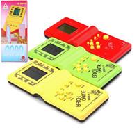 Clásico tetris mano nostálgica anfitriona jugador jugador celebrado electrónico juego juguetes consola para niños jugando diversión juego de ladrillo enigma handheld e9999