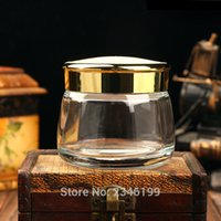 Tarjetas de almacenamiento Botellas 130ml 130g 5pcs / lot vacío de cristal transparente cosmético frasco con tapa de plata de oro, contenedor de máscara de clase alta, caja de facil
