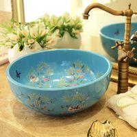 Lavabi in ceramica Bacinella Lavello in lavandino Bagno Lavello rotondo Lavabo di moda lavabo Lavello Art Lavabo in ceramica Fiore e uccello Blu
