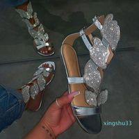 Venta-2020 mujeres calientes plana plano nuevo verano de lujo de fondo de la mariposa del Rhinestone de las sandalias zapatos de cuero del tirón de la sandalia al aire libre Flops
