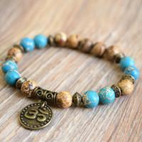MG0788 nuovo disegno di Diaspro Braccialetto Blu Regalite Pietra Om Yoga fascino del braccialetto bordati Mala polso