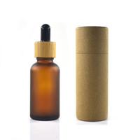 100 шт. 30 мл матовой янтарной стеклянной бутылки с бамбуковой крышкой с бумажной трубкой упаковки