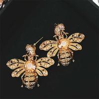 Regalos del patrón lindo de la abeja cristalina de la señora Espárragos Personalidad Shinning Diseño Fiesta del perno prisionero del encanto de las mujeres Pendientes Marca niñas