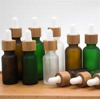 10ml Frosted Clear Szklana butelka kroplomierza z bambusa pokrywa czapka szklana olejek butelka matowa zielona butelka perfum DHL SN2396