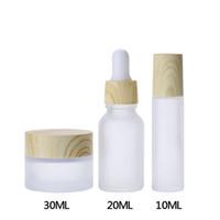 متجمد الزجاج مستحضرات التجميل الحاويات مع الخشب الحبوب كاب، جرة جولة 30ML، 20ML العين بالقطارة زجاجات، زجاجات 10ML الأسطوانة للعطور من الضروري النفط