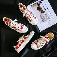 Strawberry High-top Sapatos de lona Estudantes masculinos Versão coreana da tendência dos casais 2019 novos sapatos brancos