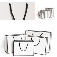 كرافت ورقة ثخن حقائب بطاقة الأبيض التعبئة حقيبة الإعلان الأزياء تخزين حقيبة يد حزب التسوق مخصص الملابس 1 86gr B2