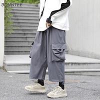 Pantalones casuales de los hombres de la pierna ancha de bolsillo elástico de la cintura sólida para hombre Hip Hop floja elegante de Calle Harajuku Todo-fósforo de la manera simple Ins