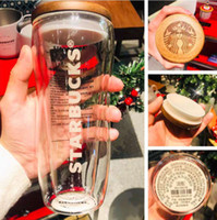 أحدث 10 أوقية ستاربكس القدح، كوب قهوة زجاج مزدوج، نمط غطاء الخشب الصلب مطبوعة مع شعار، دعم التخصيص