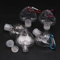 50ML شكل قلب زجاجة المطهر من ناحية مع حلقة رئيسية هوك زجاجة من البلاستيك الشفاف لإعادة الملء زجاجة السفر الرئيسية لهجات T2I51380