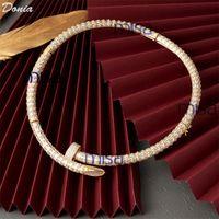 Donia Schmuck Big Nail Kupfer Micro Inlaid Zirkon Halskette Ring Armband Ohrringe Vier Sets Zubehör Designer Set