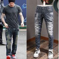 Clássico 5 bolsos azul jeans homem com manchas de pintura e detalhe de ponto 2020 quente e novo cowboy