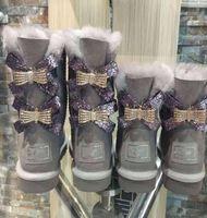 شحن مجاني جديد أحذية الثلج الاسترالية أنبوب الأوسط الأحذية أزياء القطن الدافئة المرأة BOWKNOT حجم الحفر حذاء الثلوج