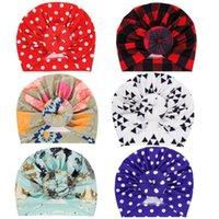 10pcs Nishine / Cappello Turbante bambino molto con la sfera rotonda punto stampato bambini Cappello Miscela del cotone Newborn Beanie bambini Baby Shower regalo