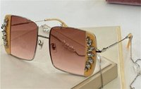 New fashion design sunglasses OMU56VSO square metal frame, pearl chain, diamond patch design, versatile shape uv400 protective glasses