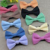 los niños sólidos del bowtie arqueamiento bebé tie15 colores se ajustan al niño hebilla del bowknot de la corbata del lazo de regalo de Navidad para el Trabajo