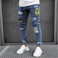Erkekler Nefes Jeans İlkbahar Sonbahar Erkek Kişiselleştirilmiş Rozet Dekorasyon Orta Bel Elastik İnce Uzun Pantolon Jean Ripped Ripped