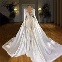 Muslim Long Luxury Wedding Dresses 2020 Pearls Beading Elegant Long Sleeves Dubai Bridal Gowns 2020 Newest Wedding Gowns