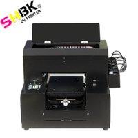 Nuovo multifunzionale stampante flatbed UV a getto d'inchiostro in formato A4 per la cassa del telefono, cuoio, legno, vetro, maglietta, penna, acrilico, carta del PVC