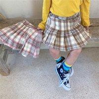 Новый стильный Дети Девочки Юбки плед юбка девушки весна осень школа Ruffles Хлопок Детская одежда Детская девочка Юбки