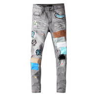 Neue Ankunft Herren Designer AM-Jeans Classic Straight Patch Jeans Hosen Berühmte Marke Reißverschluss Marmorierung Slim Bein Hot Top Sale US Größe 29-40