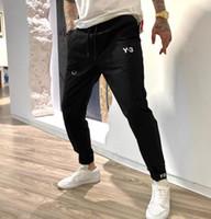 20ss calças homens executando sweatpants solto importado tecido impermeável tecido sentir suave macio e delicado algemas com nervuras tamanho asiático calças pretas