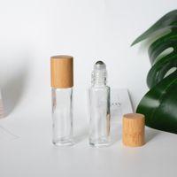 10 ml heldere glazen rollerflessen met natuurlijke bamboe houten deksels etherische olierol op verpakking buizen