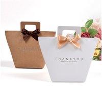 Kraft Paper Bags Celebration Wedding Gifts stampa Forma arco vestiti Shopping Nave Caramelle Snack Bag Forte confezionamento a caldo di vendita 0 65ss F2