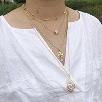 Collane pendenti Star Croce perline Boho Ocean Beach Shell Multi Livelli Cowrie Seashell per le donne Gioielli estivi Collares Collier