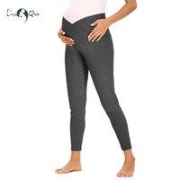 Fondos de maternidad High Cinturon Tummy Control Pantalones casuales Pantalones leggings sobre el entrenamiento del vientre con los bolsillos para las mujeres