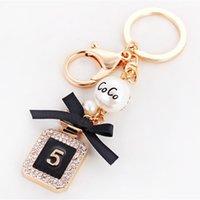 Bouteille créatif Parfum Keychain Femmes Sac charme cristal strass porte-clés anneau de mode Porte-clés de voiture Porte-clefs Trinket