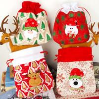 Adornos de la decoración de la Navidad Santa Sacos de lino Bolsa no tejida con cordón Bolsos de regalo de caramelo Imprimir Muñeco de nieve Festival personalizado Fiesta