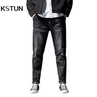 KSTUN jeans for men straight fit through the hips and thighs...
